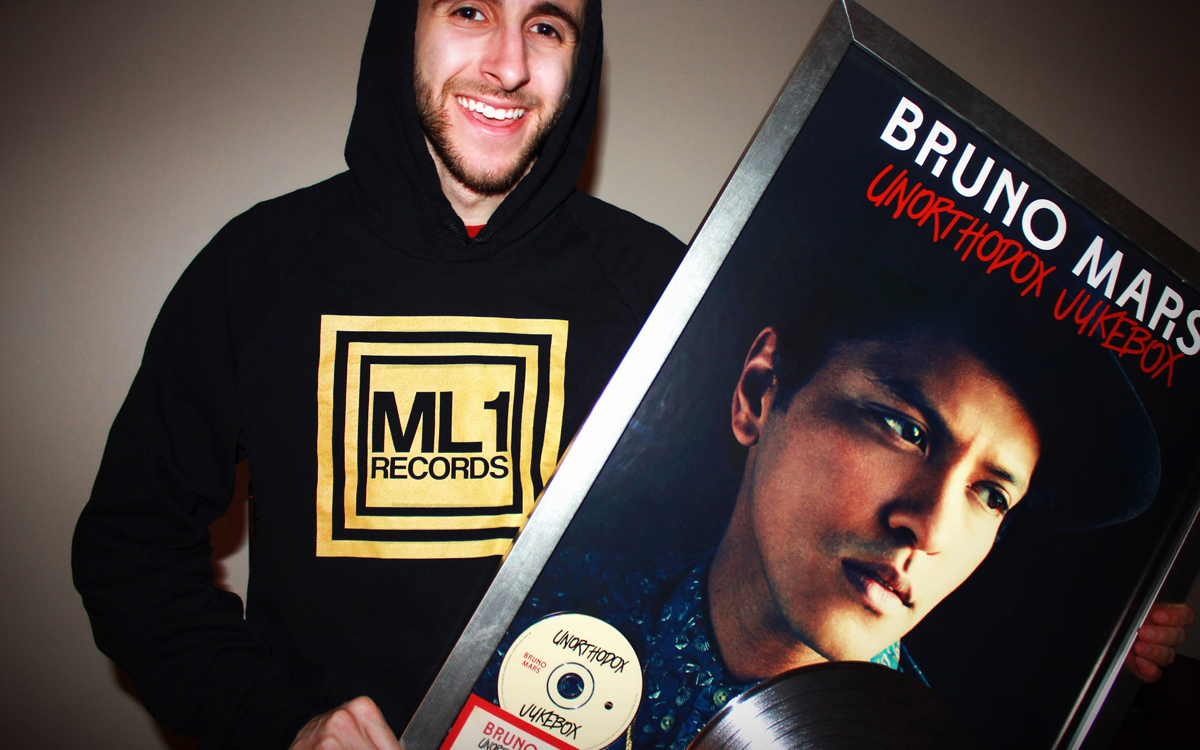 Joseph Karre with Bruno Mars RIAA Platinum Plaque for Unorthodox Jukebox